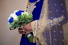 Asian bride bouquet. Asian bride holding blue white bouquet Royalty Free Stock Images
