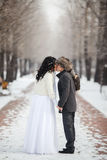 Asian bride and groom kissing in the middle of Stock Photography