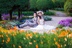 Asian Bride and Groom Sitting Together in Garden.  Stock Images