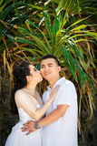Asian bride and groom on a tropical beach. Wedding and honeymoo. N concept Stock Photos