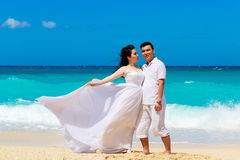 Asian bride and groom on a tropical beach. Wedding and honeymoon Royalty Free Stock Photography