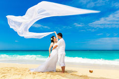 Asian bride and groom on a tropical beach. Wedding and honeymoon Stock Photo