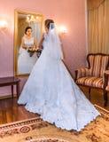 Asian bride and mirror Stock Photos