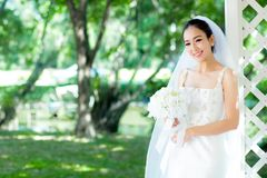 Asian bride at outdoor in a morning. The asian bride at outdoor in a morning Stock Photo