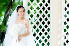 Asian bride at outdoor in a morning. The asian bride at outdoor in a morning Royalty Free Stock Photos