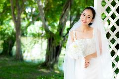 Asian bride at outdoor in a morning. The asian bride at outdoor in a morning Stock Photos