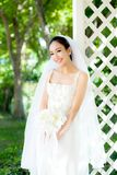 Asian bride at outdoor in a morning. The asian bride at outdoor in a morning Stock Images