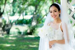 Asian bride at outdoor in a morning. The asian bride at outdoor in a morning Stock Photography