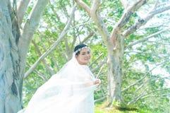 Asian bride. Outdoor portrait of a beautiful asian bride Stock Image