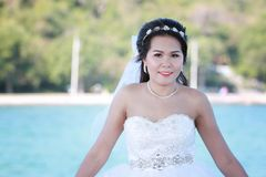 Asian bride photographed before marriage is Pre-wedding on Koh S. I Chang Island Popular locations in the Chonburi province at Thailand Stock Photos