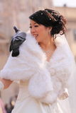 Asian bride with pigeon. At the piazza duomo in milan, italy. For a small amount of money you can have your picture taken with the pigeans at the piazza duomo Stock Photography