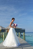 Asian bride in seaside wedding pose Stock Photo