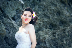 Asian bride on a tropical beach. Wedding and honeymoon concept. Royalty Free Stock Photos