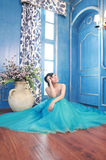 Asian bride. In the wedding dress sitting on the floor Stock Photos