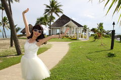 An asian bride wedding in front of the chapel Royalty Free Stock Photography