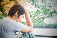 Asian broken heart man listening music, Vintage style color Royalty Free Stock Photo