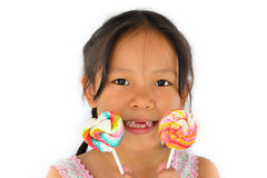 Asian broken teeth girl and big lollypop Stock Image