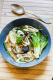 Asian broth with pak choy Stock Images