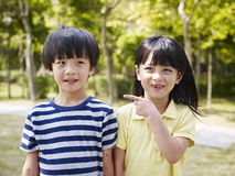 Asian brother and sister. Looking cute and funny Royalty Free Stock Image