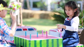Asian brother and sister playing plastic toy together stock footage