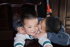 Asian brothers. Portrait of young Asian brothers with  around eachother smiling Royalty Free Stock Photo