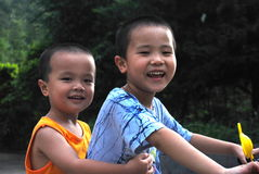 Asian brothers. Portrait of young Asian brothers with  around eachother smiling Royalty Free Stock Photos