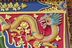 Asian buddhist temple  ornate dragon on wall Royalty Free Stock Photos