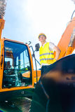Asian builder in excavator on construction site Royalty Free Stock Images
