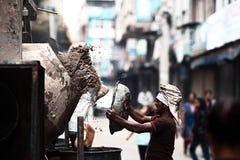 Asian builder. Hard work of the Asian builder Stock Photo