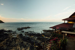 Asian bungalow against a calm sea. Landscape bungalows rocky seashore Royalty Free Stock Photography