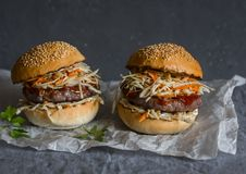Asian burger with hoisin ketchup and chili mayo on a gray background. Asian style. Hamburger royalty free stock images