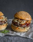 Asian burger with hoisin ketchup and chili mayo on a gray background. Asian style. Hamburger stock images