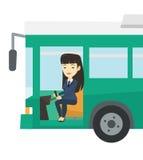 Asian bus driver sitting at steering wheel. Stock Image