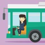 Asian bus driver sitting at steering wheel. Royalty Free Stock Photos