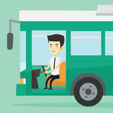 Asian bus driver sitting at steering wheel. Stock Photography