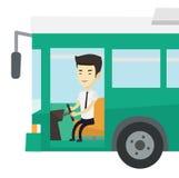 Asian bus driver sitting at steering wheel. Stock Photos