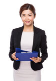 Asian business assistant with clipboard Stock Photo