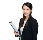 Asian business assistant with clipboard Stock Images