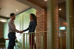 Nice to meet you. Asian business collegues shaking hands before meeting in office Stock Image