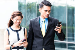 Asian business couple going to work Royalty Free Stock Images