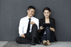 Asian Business couple using an iPad Stock Image