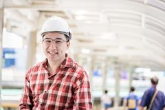 Asian business and engineer man with red scott shirt has plannin stock images
