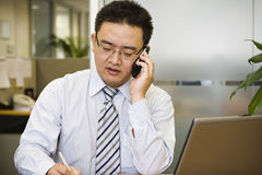 Asian business executive. Working in office Royalty Free Stock Photo