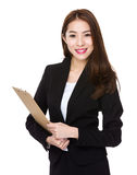 Asian business executive with file pad Stock Photos