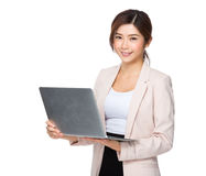 Asian business executive useing notebook computer Royalty Free Stock Image