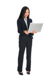 Asian business female on a laptop Stock Photos