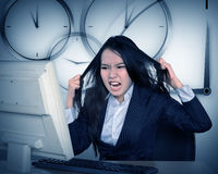 Asian business get angry because overtime work Royalty Free Stock Photos