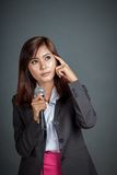 Asian business girl hold a microphone and think Royalty Free Stock Images