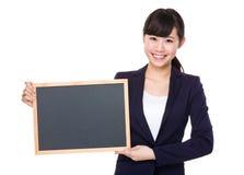 Asian business girl holding blank blackboard Royalty Free Stock Photography