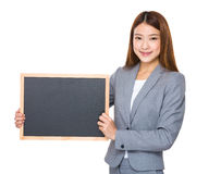 Asian business girl holding blank blackboard royalty free stock image